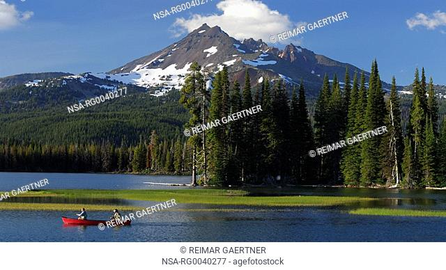 Panorama of canoers on Sparks Lake under Broken Top in Oregon