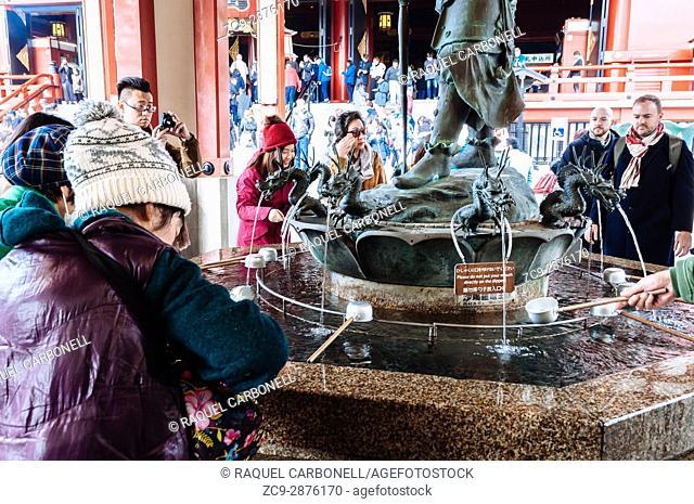 People around fountain in Sensoji temple, Tokyo, Japan