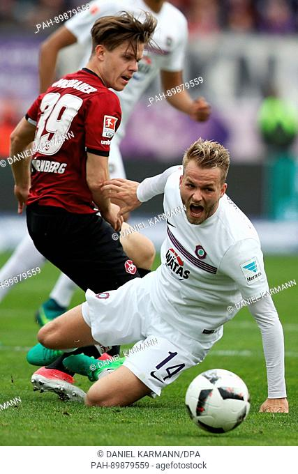 Nuremberg's Patrick Kammerbauer (L)and Aue's Pascal Koepke vie for the ball during the German 2nd division Bundesliga soccer match between 1