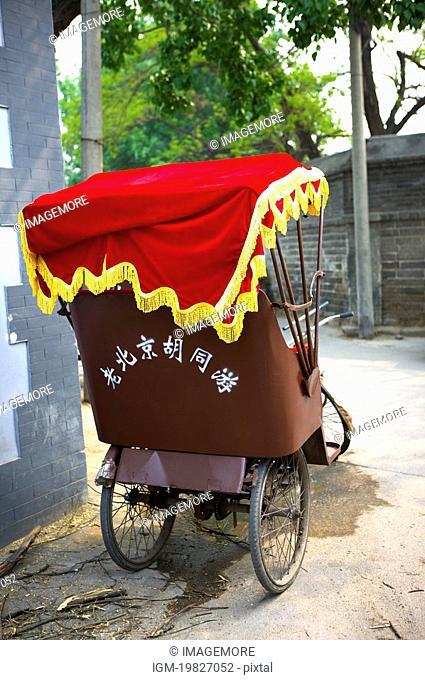 Rickshaw parking in the street