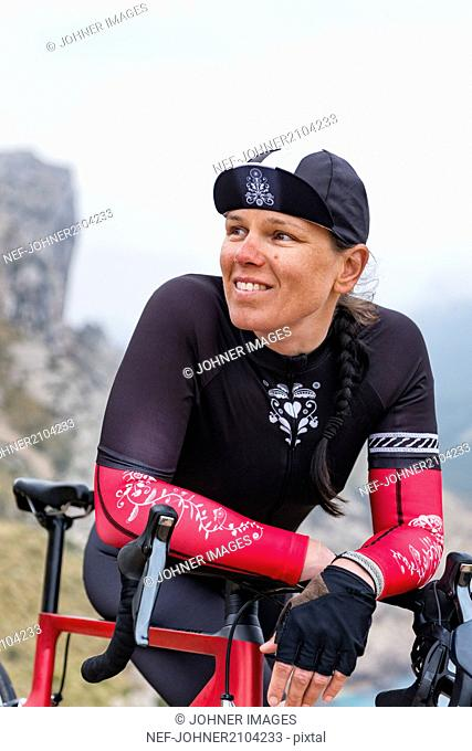 Woman in cycling clothes resting