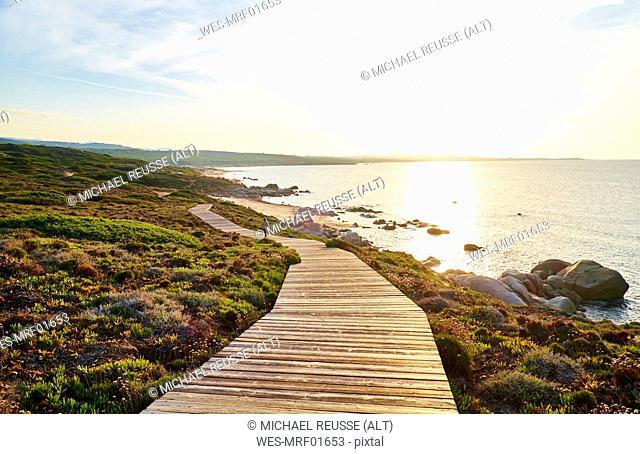 Italy, Sardinia, Lu Litarroni, coastal path at sunset