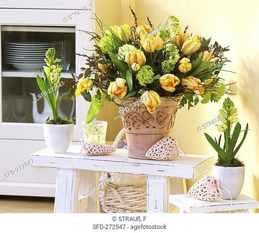 Spring arrangement of tulips & Viburnum, hyacinths beside it