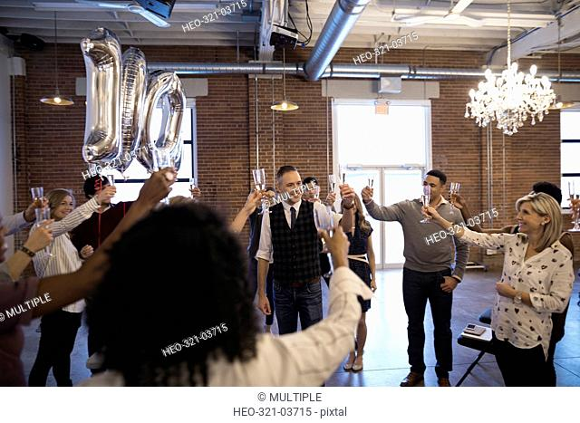 Business people celebrating milestone toasting champagne
