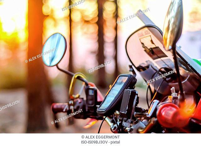 Windshield and controls of touring motorcycle at sunset, close up, Yosemite National Park, California, USA
