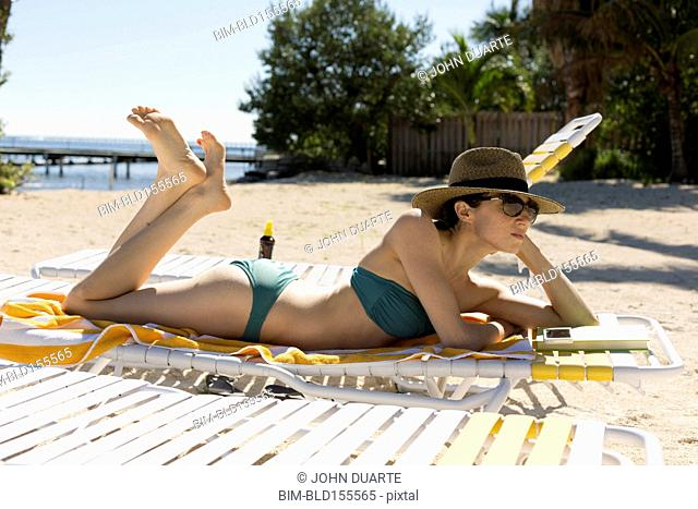 Caucasian woman relaxing on beach