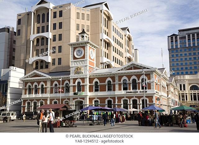 Christchurch Canterbury South Island New Zealand  Old Post Office building 1879 and clock tower in Cathedral Square in city centre busy with people  Now tourist...