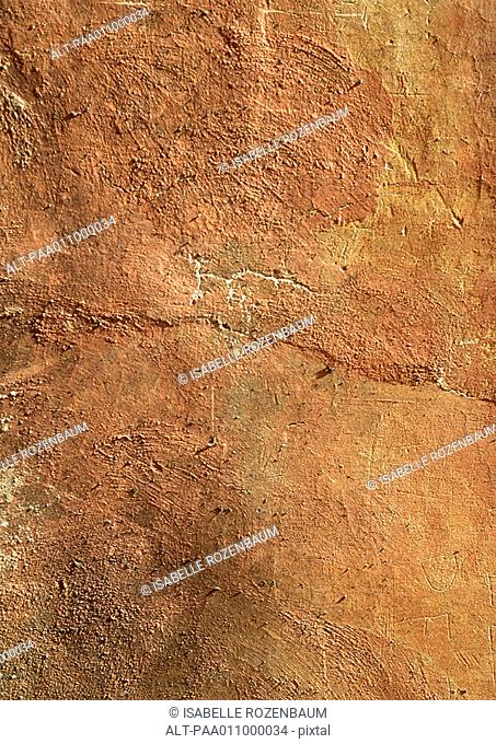 Terracotta colored wall, close-up