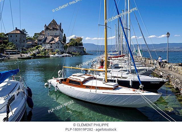 Sailing boats in front of the Château d' Yvoire, medieval castle at Yvoire along Lake Geneva / lac Léman, Haute-Savoie, France