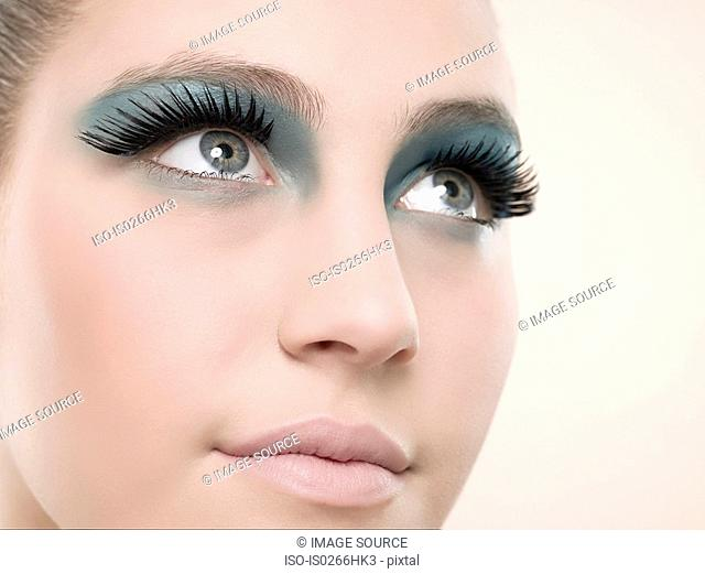 A young woman wearing false eyelashes