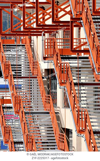 Red metallic stairs in Marseille's docks, France