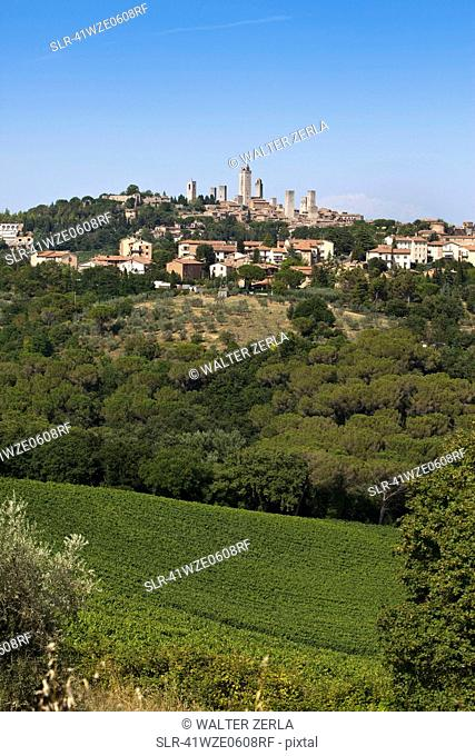 City on hillside in rural landscape