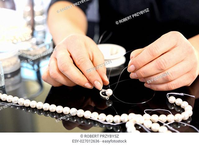 jewelery making,threading beads. jeweler,pearl necklace