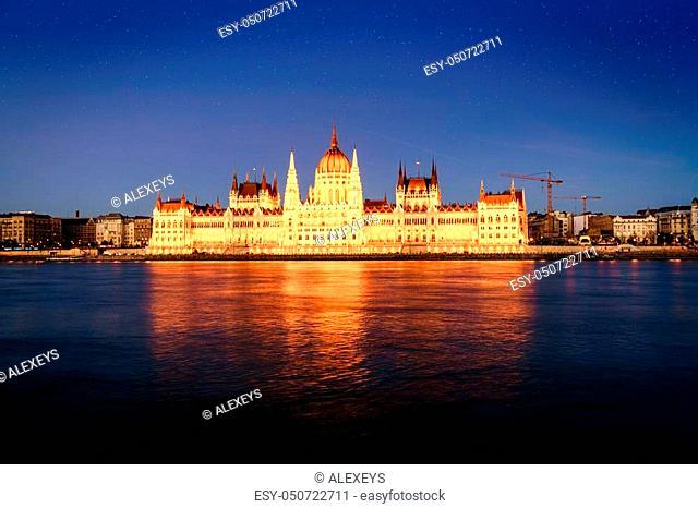 Beautiful view of Hungarian Parliament Bulding reflecting in the Danube River at night