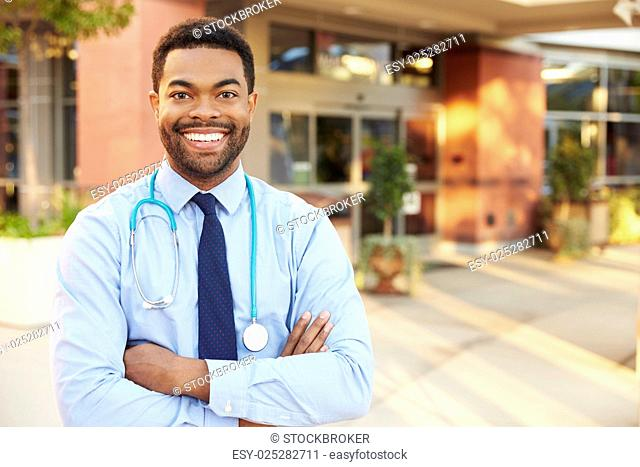 Portrait Of Male Doctor Standing Outside Hospital