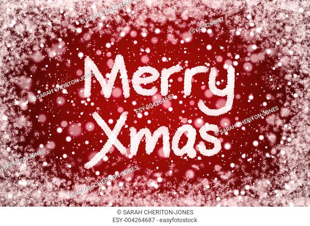 Christmas Red Background with Merry Xmas Text in Snow Writing