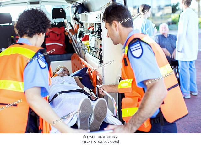 Paramedics examining patient in ambulance