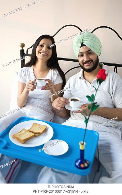 Sikh couple eating breakfast