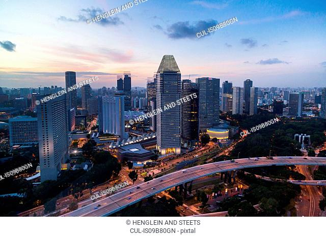 Elevated cityscape with highway and skyscrapers at dusk, Singapore, South East Asia