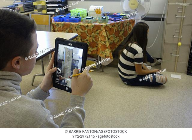 8th Graders Using iPad to Record Experiment in Science Classroom, Wellsville, New York, USA
