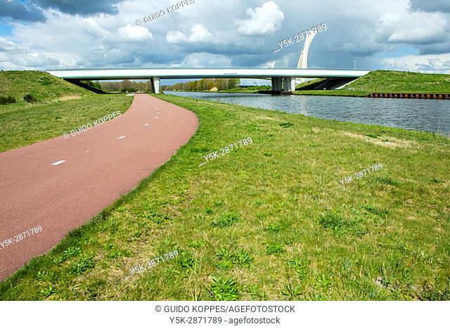 Tilburg, Netherlands. Newly build bridge supporting road traffic crossing the Wilhelmina Canal and a biker's cycling road