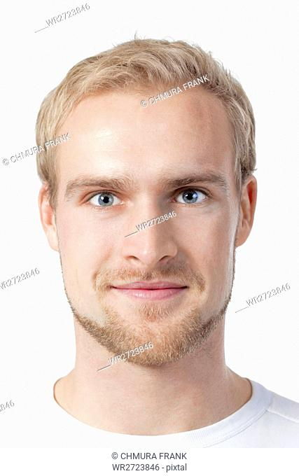 portrait of a young man with blond hair - isolated on white