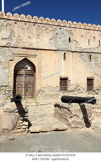 two old traditional cannons in front of the facade of Fort Quriat in the village Quriat, Sultanate of Oman, Asia