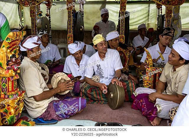 Jatiluwih, Bali, Indonesia. A Gamelan Orchestra, Luhur Bhujangga Waisnawa Hindu Temple. Men in front are playing cymbals and a gong