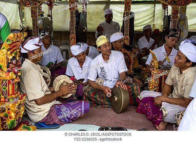 Jatiluwih, Bali, Indonesia. A Gamelan Orchestra, Luhur Bhujangga Waisnawa Hindu Temple. Men in front are playing cymbals and a gong