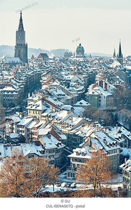 High angle view of city and skyline with snow covered rooftops, Berne, Switzerland