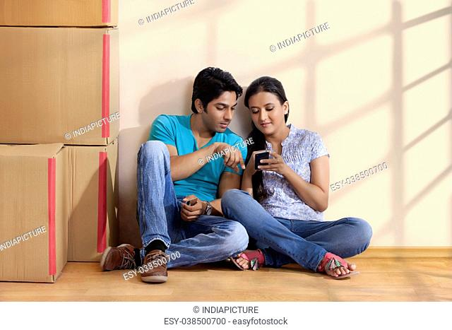 couple sitting and using mobile