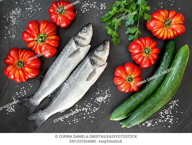 Fresh sea bass with tomatoes, cucumbers and fresh parsley