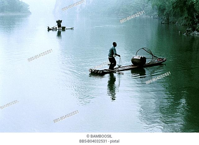 Fishing boats on the River Li, Yangshuo County, Guilin City, Guangxi Zhuang Nationality Autonomous Region of People's Republic of China