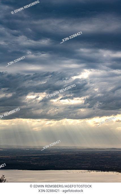 The sun bursts through the clouds in Lake Nakuru National Park, Kenya
