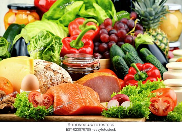 Variety of organic food including vegetables fruit bread dairy and meat. Balanced diet
