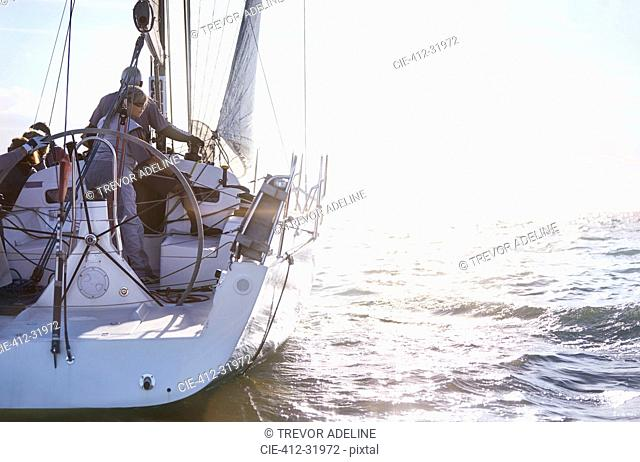 Retired couple sailing on sunny ocean