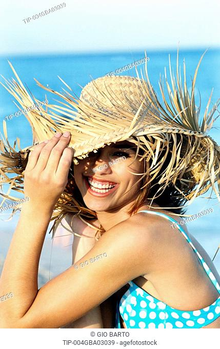 Woman with bikini and hat