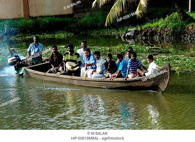 PEOPLE ON A BOAT, CHAMPAKULAM, KERALA