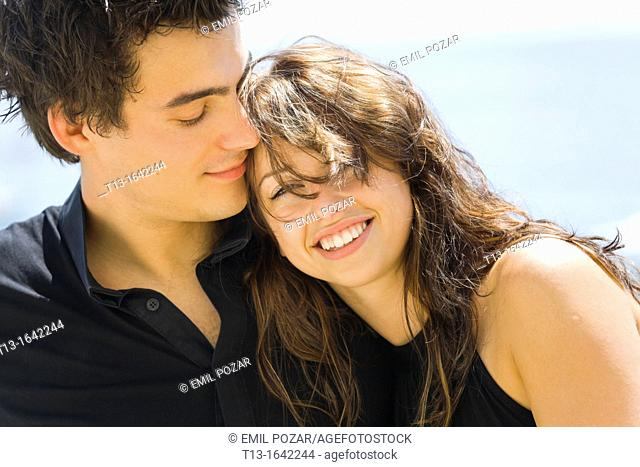 Young couple tight portrait