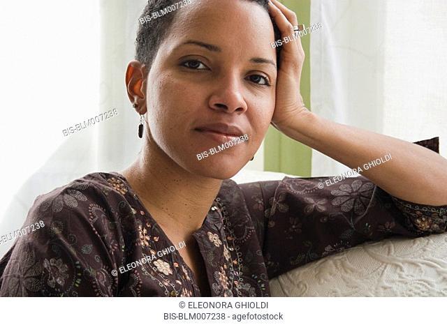 African American woman on sofa