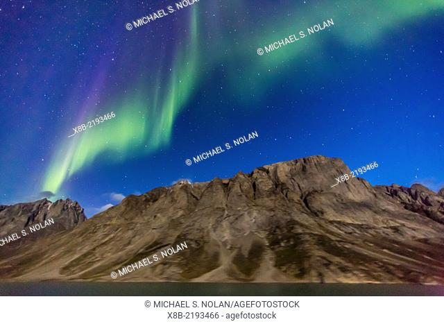 The aurora borealis from the bow of the National Geographic Explorer in Kangerlussuaq Fjord, Greenland