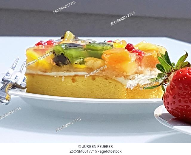 piece of colorful fruit cake with strawberry