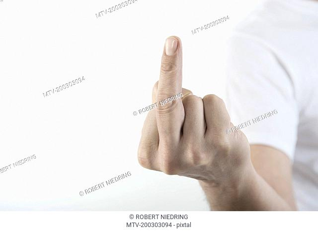Close-Up Of a man's hand showing obscene gesture, Bavaria, Germany
