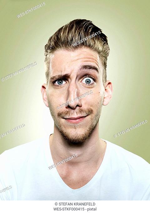 Portrait of doubtful young man, studio shot