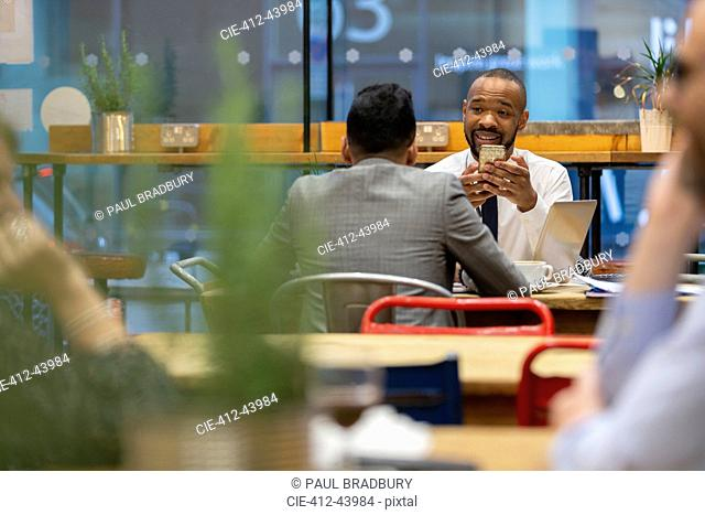 Businessmen with smart phone working in cafe