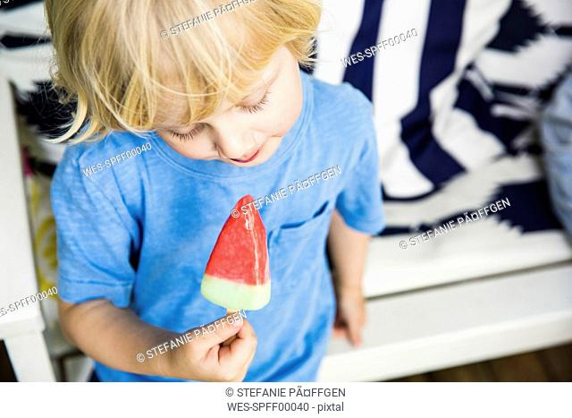 Blond little boy with ice lolly