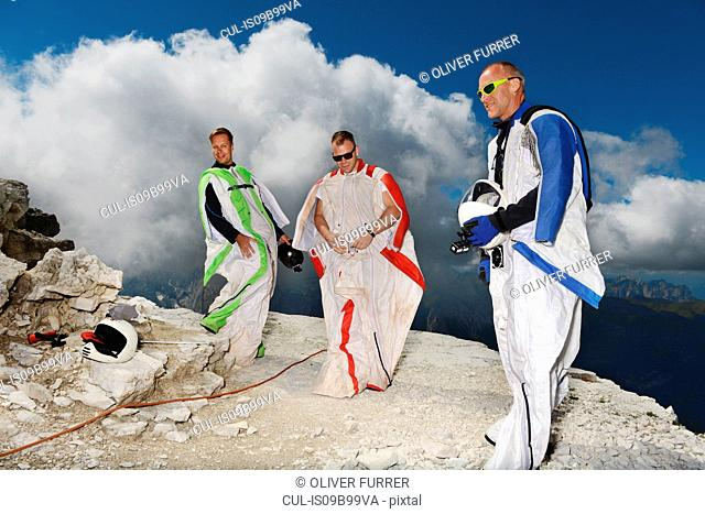 Base jumpers on dolomite mountains wearing wingsuits, Canazei, Trentino Alto Adige, Italy, Europe