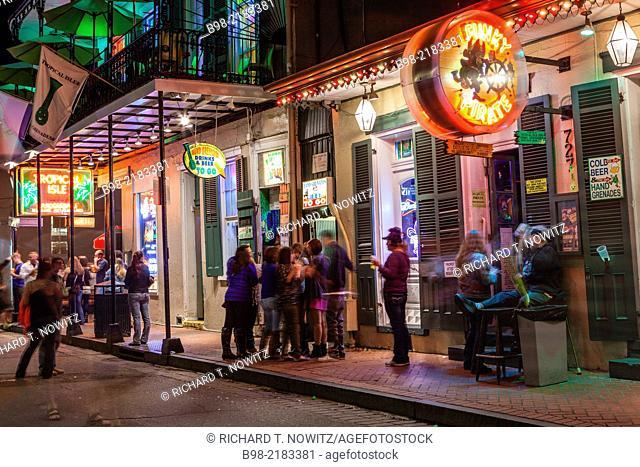 Tourists enjoy the nightlife on Bourbon St