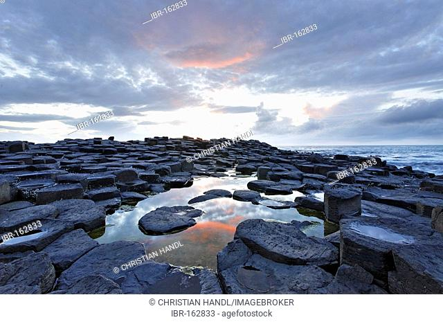 Sunset at the basalt columns of the Giant's Causeway, Londonderry, North Ireland