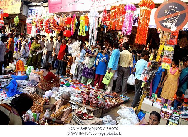 Indian Deepawali diwali festival ; sale of Decorative Items oil lamps lanterns and rangoli colors on the footpath ; Dadar Market ; Bombay Mumbai ; Maharashtra ;...